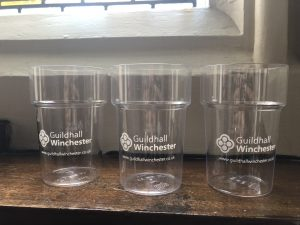 3 Guildhall Winchester reusable cups on a shelf