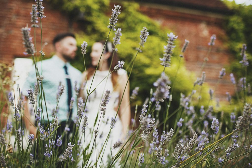 Couple in Abbey Gardens out of focus behind lavender