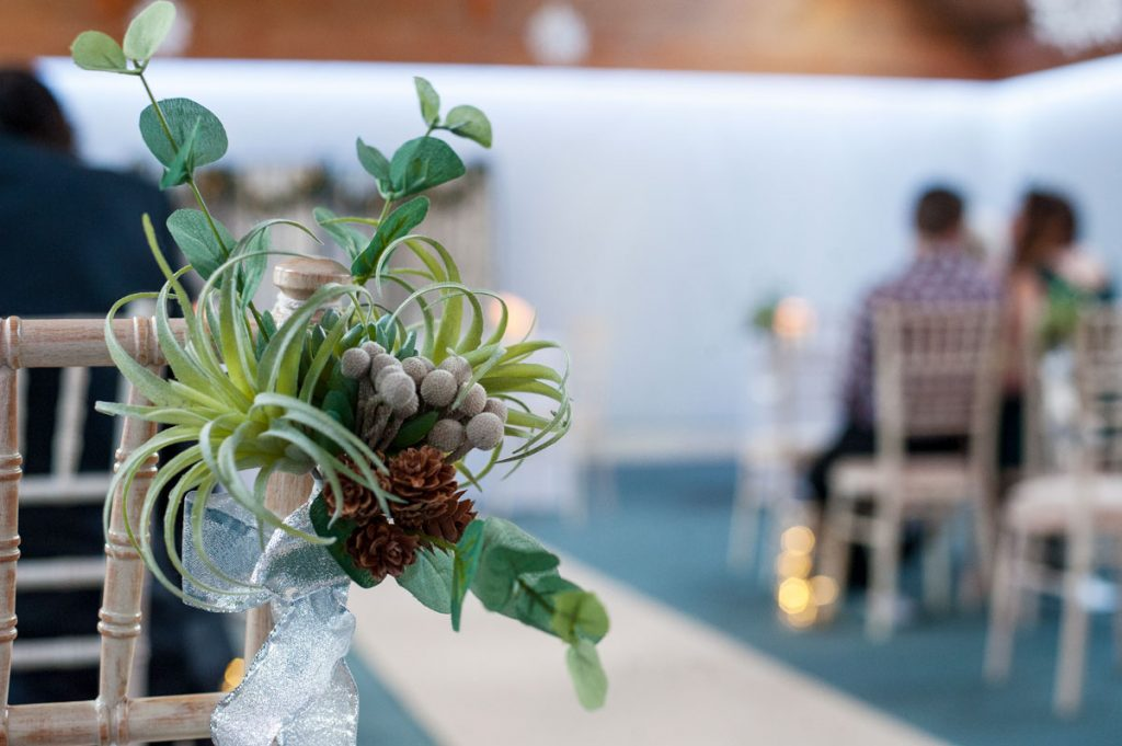 Wedding ceremony in Walton Suite with winter flowers
